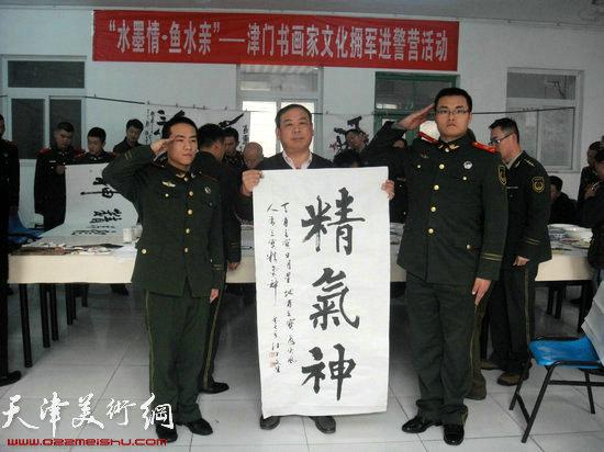季康、孙世萌向马文生先生行军礼拜师学书法
