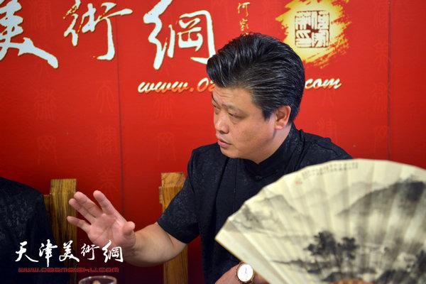 著名书画家阎尔新做客天津美术网