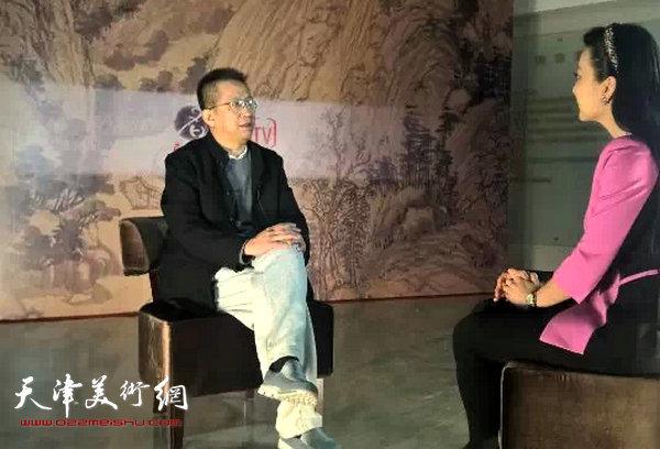 李毅峰先生在第五届中国画节新华社・新华名家栏目直播间接受采访