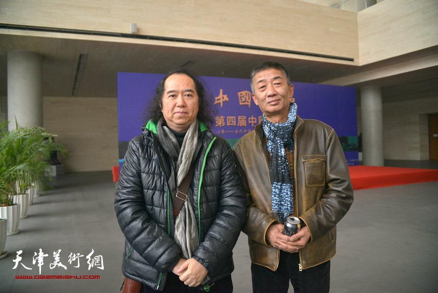 邓国源、祁海平在画展现场