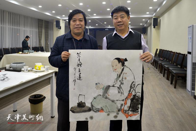 李耀春、张养峰在金带福路文化中心。