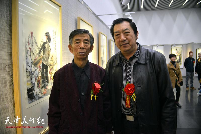 刘维仑与孙玉河在画展现场。