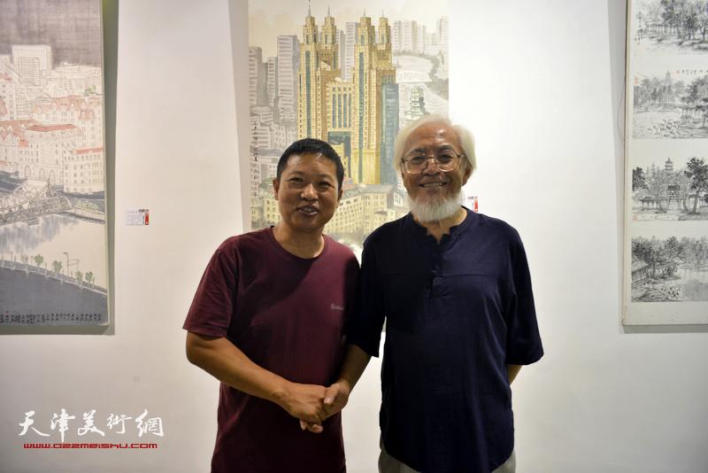 李庆增、魏瑞江在画展现场。
