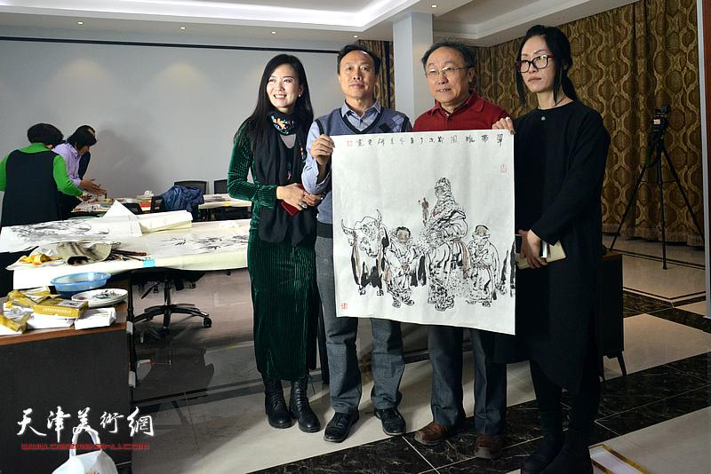 左起:康萍、尹秋海、何东、杨悦在活动现场。