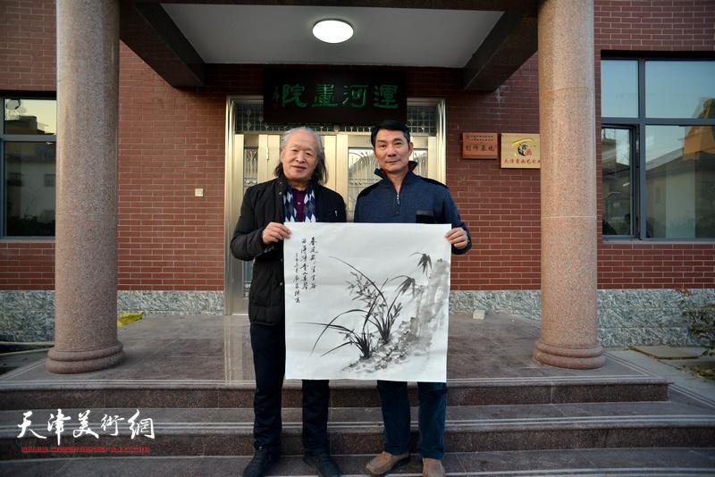 左起:刘家栋、孟宪奎在活动现场。