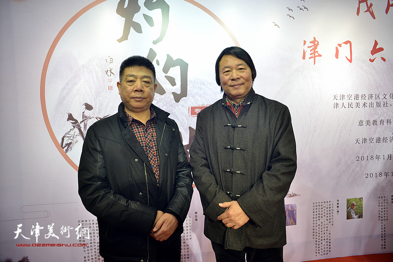 杨跃泉、张养峰在书画展现场。