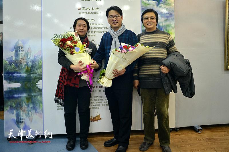 滑寒冰、范宁、刘波在展览现场。
