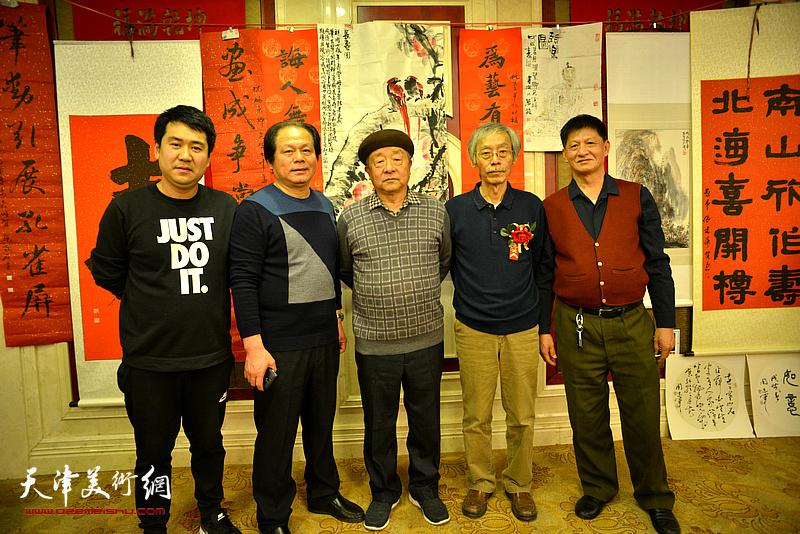 姚景卿与况瑞峰、刘士忠、谭庆维、刘浩在活动现场。