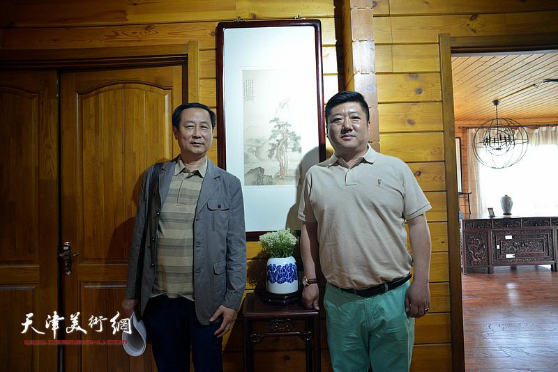 左起:赵达仁、郭有泉在缪文杰书画艺术品鉴活动现场。