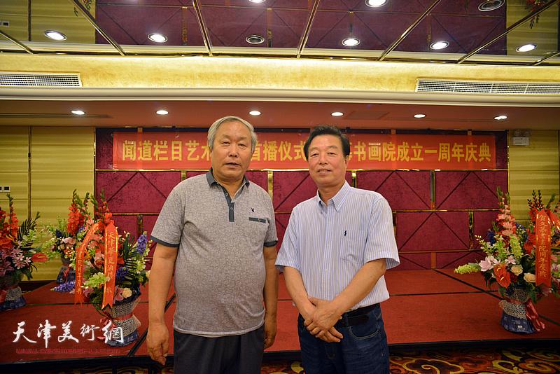 左起:唐云来、杨建国在活动现场。