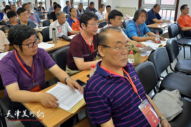 陈传武、王惠民、李根友在会议现场。