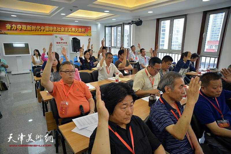 张同明、苏玉作、赵清、萧振华在会议现场。