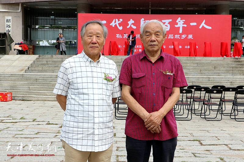 左起:姬俊尧、纪振民在活动现场。