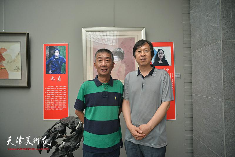 邓国源、路洪明在画展现场