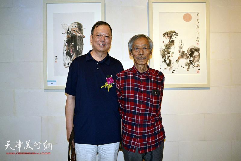 姚景卿、韩捷明在画展现场。