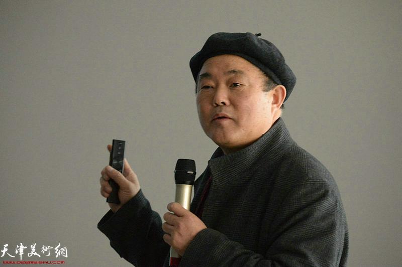 张新根在摄影讲座上畅谈。