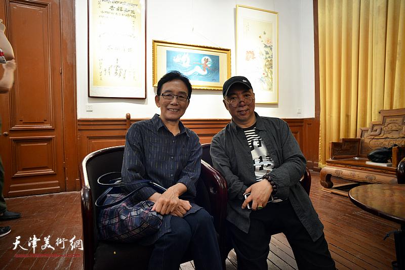 卢东升与肖慧珠在展览现场。