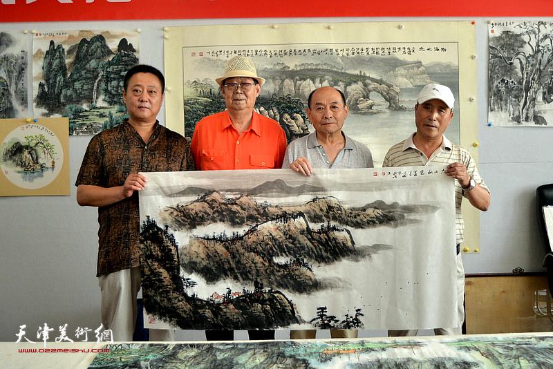 """郭永元与他的三位弟子陈向立、张迎、张志刚在""""师情画意""""栏目。"""