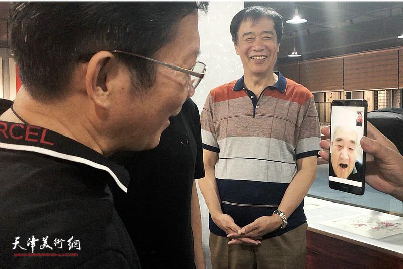 孙伯翔先生以视频对话方式与茂名市书画院院长廖静交流。