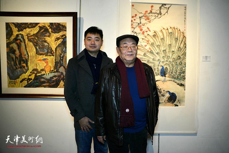 孙季康、黄易非在画展现场。