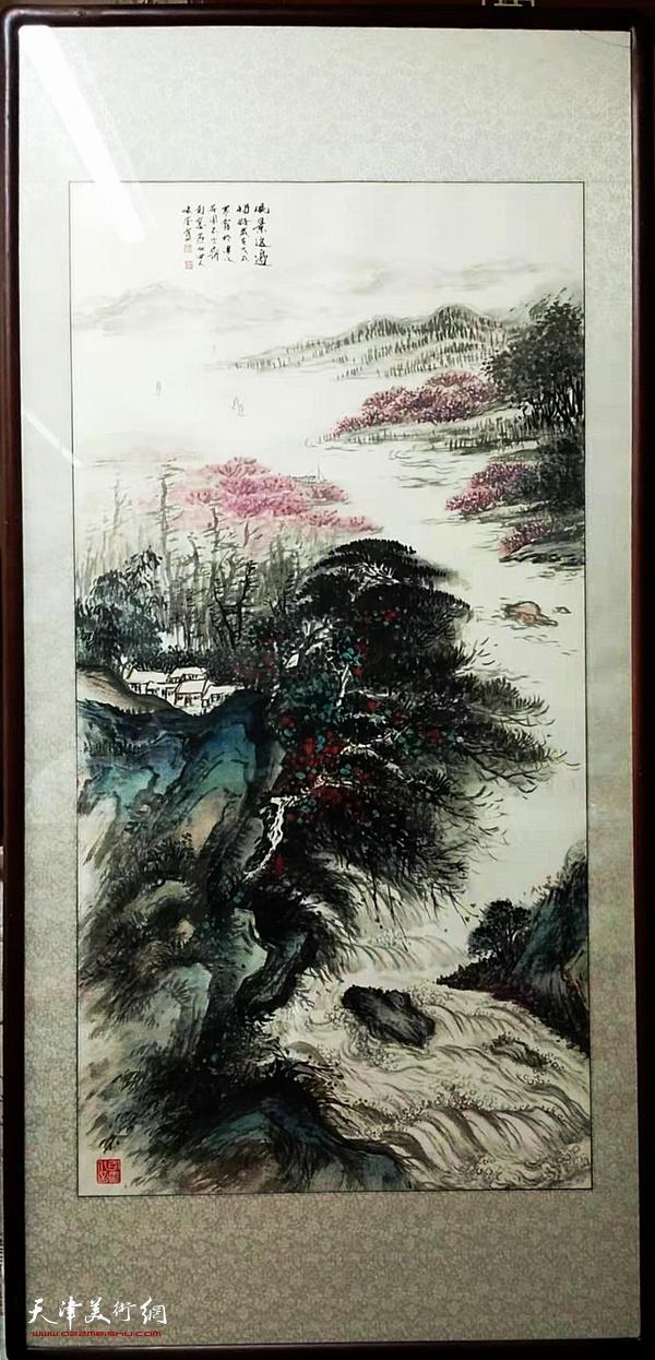 图为现场展示的穆怀安山水画作品